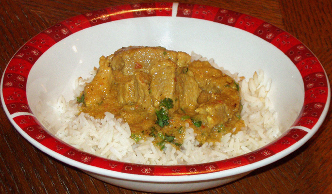 Classic spicy Indian curry with pork, served with saffron rice.