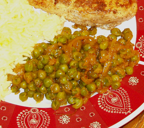 Spicy green peas and onions with saffron rice and spiced chicken.