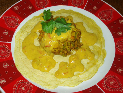 Vegetable dosa with coconut curry sauce