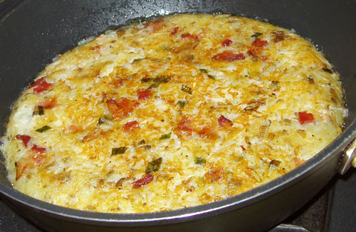 Röschti with bacon, onions, and cheese