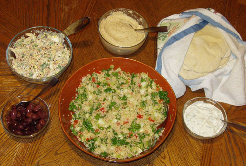 My mezze consisted of olives, piyaz, hummus, pita bread, cucumber raita, and tabouli.