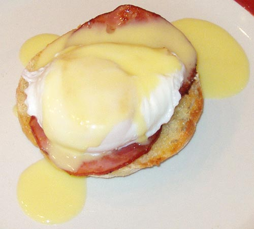 Hollandaise Sauce on top of Eggs Benedict