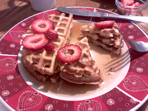 Waffles with strawberries and syrup