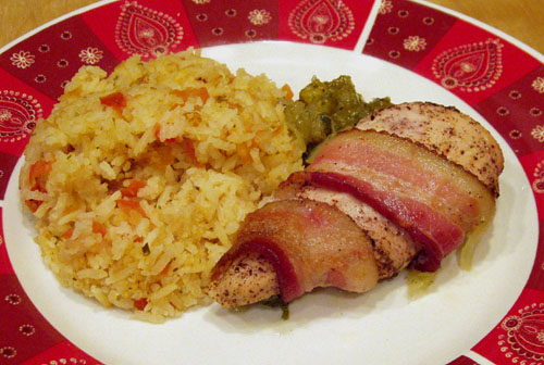 Bacon wrapped around chipotle lime chicken, with rice and salsa.  Oops, forgot my beans!