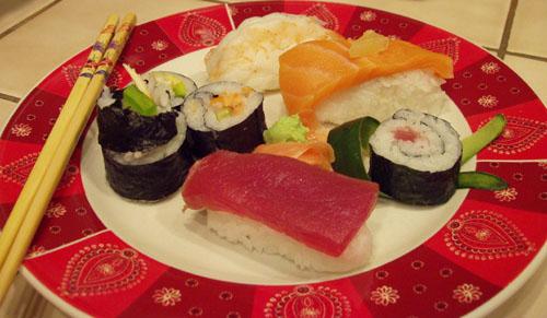 From the chopsticks, clockwise: California rolls, Seattle rolls, ebi nigiri, sake nigiri, tuna roll, maguro nigiri