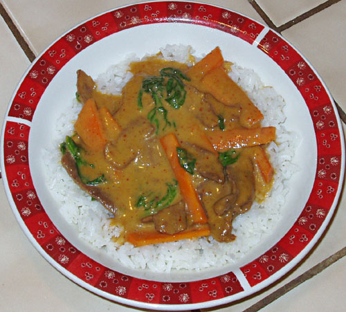 Curried beef with vegetables on rice